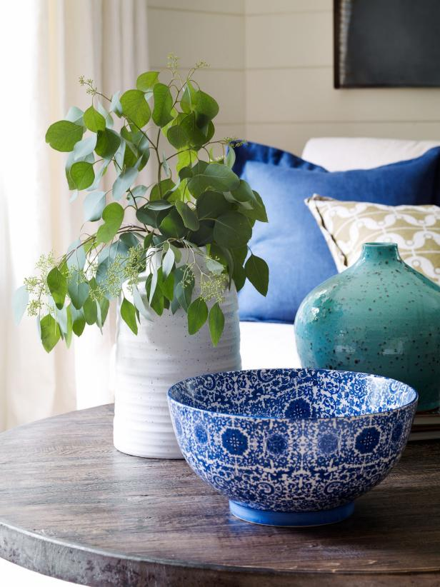 Coffee Table With Blue and White Ceramic Bowl and Plant In White Vase