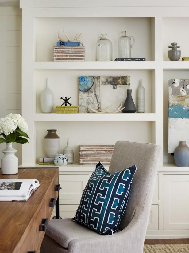 Neutral Home Office With Built-In Bookshelf and Upholstered Armchair