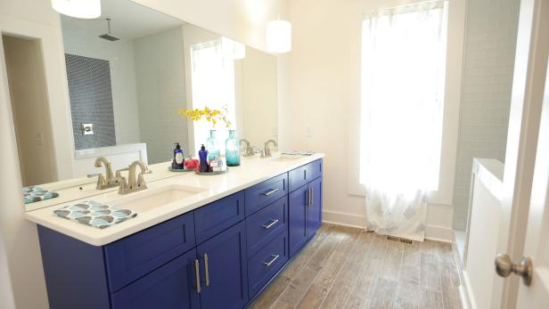 Neutral Bathroom With Blue Double Vanity and Wood-Look Tile Floor