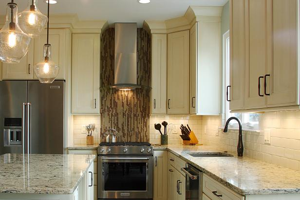Transitional kitchen with eye catching mosaic tile oven backsplash