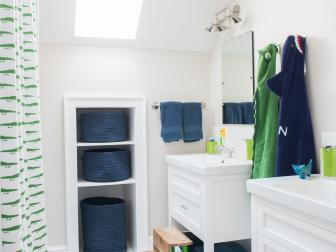 Navy and Green Details in Kids' Bathroom