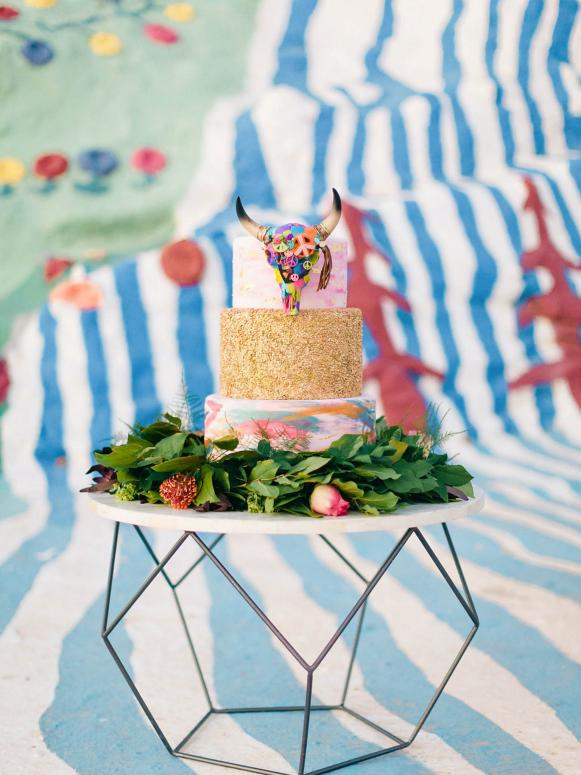 Eclectic Rainbow and Gold Wedding Cake With Southwestern Steer Head Topper
