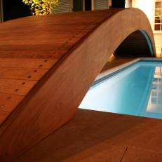 Arched, Wooden Bridge by the Pool