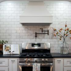 Contemporary Black And White Kitchen With Subway Tile Backsplash