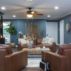 Contemporary Blue Living Room with Over-sized Brown Leather Sofas