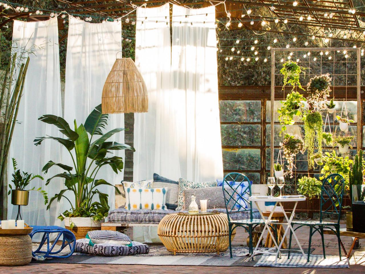 Bohemian Inspired Patio With Curtains String Lights and