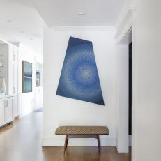 Eye-Catching Art in Clean, White Entryway