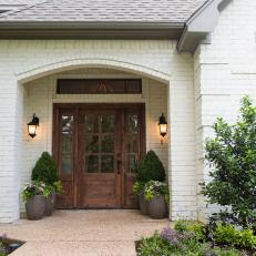 White Brick Front Entrance and Wood Door