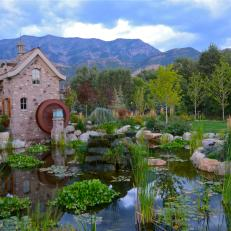 Rustic, Imaginative Kid's Playhouse With Water Wheel