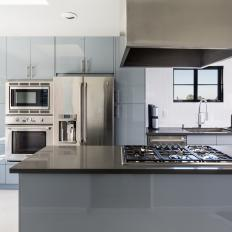 Modern Kitchen With Custom Gray Cabinets and Fume Hood