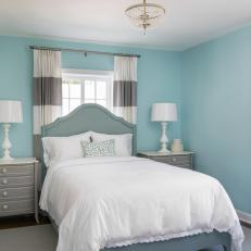 Blue Wall Color Creates Beachy Feel In Guest Bedroom