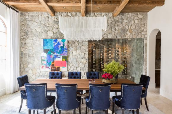Transitional Dining Room Features Stone Wall and Wood Ceiling