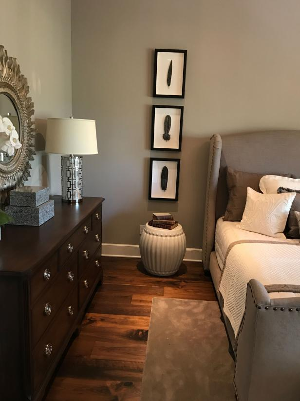 Rustic Luxury Guest Suite with Upholstered Bed and Framed Feathers