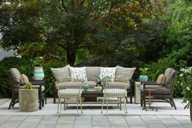 Rustic Outdoor Living Space with Couch and Chairs
