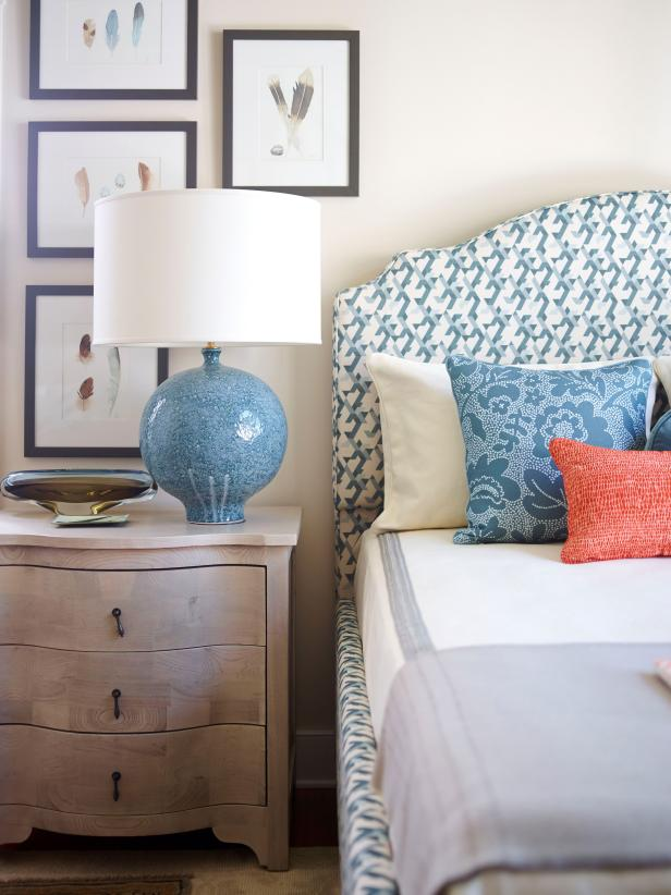 Blue and Neutral Guest Room with Framed Watercolors and Upholstered Headboard