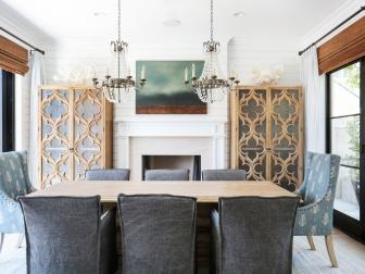 Mediterranean Dining Room With Carved Wood Cabinets