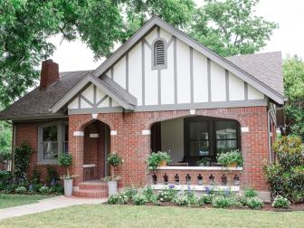 Brick Tudor Style Home Exterior with Gray Trim
