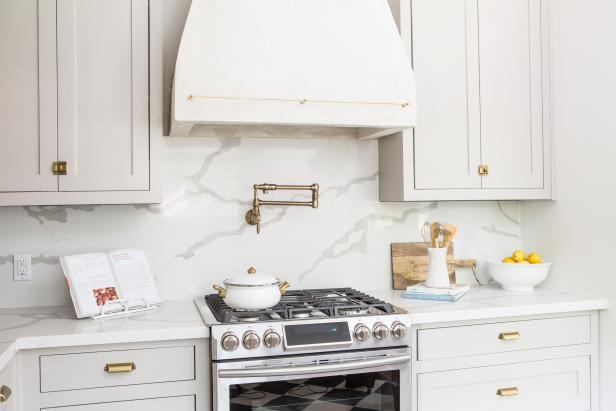 Neutral Kitchen with White Marble Backsplash and Countertops