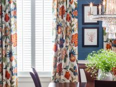 Blue Traditional Dining Room With Floral Curtains