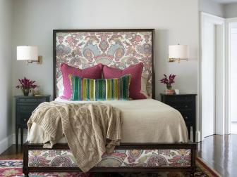 Purple, Blue and Green Master Bedroom with Patterned Rug, Upholstered Headboard and Neutral Bedding