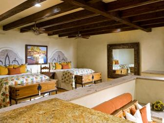 Rustic Beach Guest Bedroom with Wall-Mounted Rock Headboards, Leaf Bedding, Wood Beams