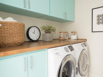 Neutral Midcentury Modern Laundry Room with Blue Cabinets