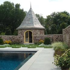 Swimming Pool and Cottage Storage Shed With Natural Rock Wall and Decorative Grass Checked Floor