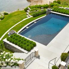 Grand Backyard Design Featuring Swimming Pool, Tiered Landscaped Yard and Shaped Shrubbery