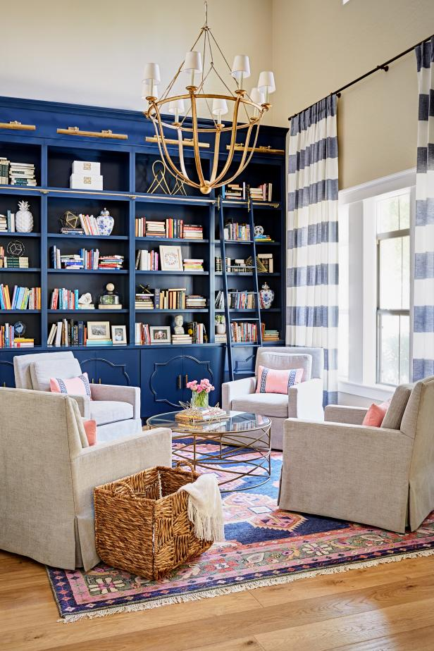 Blue and Pink Transitional Library With Striped Curtains