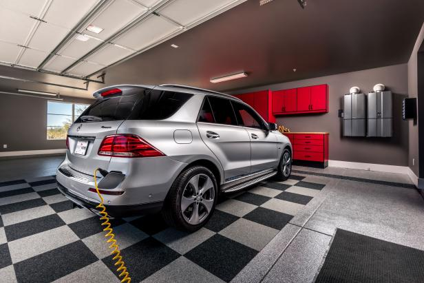 The hybrid SUV's electric motor can be charged in the garage