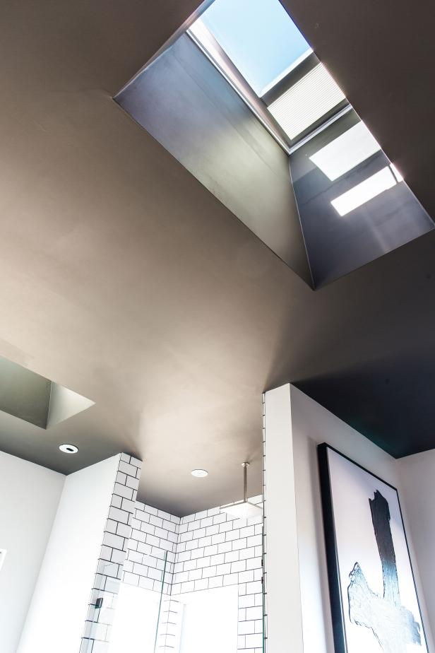 Solar-powered remote-control fresh-air skylights in master bathroom