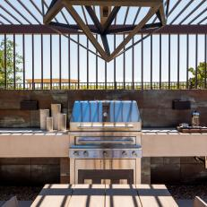 Southwestern Outdoor Kitchen With Contemporary Pergola