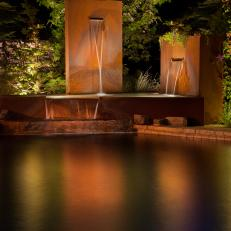 Corten Steel Water Feature Connected to Pool