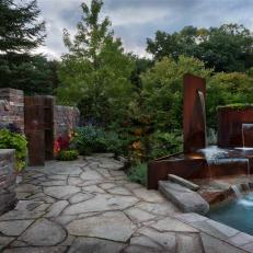 Flagstone Patio With Modern Water Feature and Pool