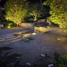 Sophisticated Front Yard Illuminated at Night