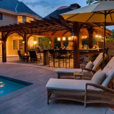 Covered Poolside Pavilion With Pergola Awning and Pendant Lighting