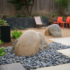 Boulder Accents Add Contrast to Whimsical Backyard Design