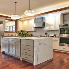 Neutral Contemporary Chef Kitchen With Marble Island