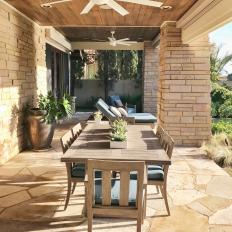 Porch With Ceiling Fans and Table