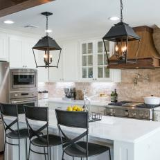 Open Concept Kitchen With White Stone Countertops And Lantern Pendant Lights