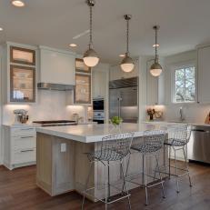 Photos hgtv white transitional kitchen with globe pendants aloadofball Image collections
