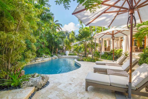 Tropical Backyard With Pool, Palm Trees, Lounge Chairs
