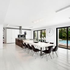 Bright and Airy Eat-In Kitchen With View of Pool