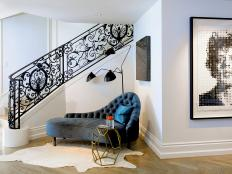 Entryway Features Plush Chaise and Intricate Railing