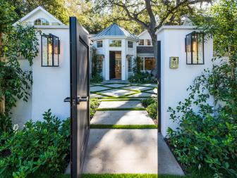 Outdoor Gate Leads to Courtyard of Beautiful White Home