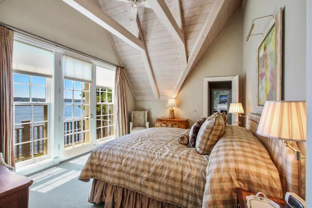 Bedroom With French Doors and Exposed Ceiling Beams