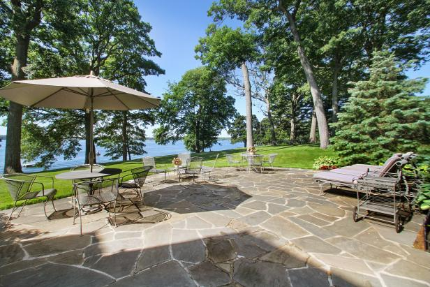 Multiple Seating and Dining Areas on Large Stone Patio