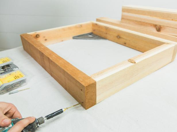 "Assemble the smaller bottom shelf frame first, using wood glue, then long wood screws. Always pre-drill first before adding wood screws to avoid splitting the wood. Using the same method assemble the larger countertop frame.  Lastly, add the 19"" center brace."