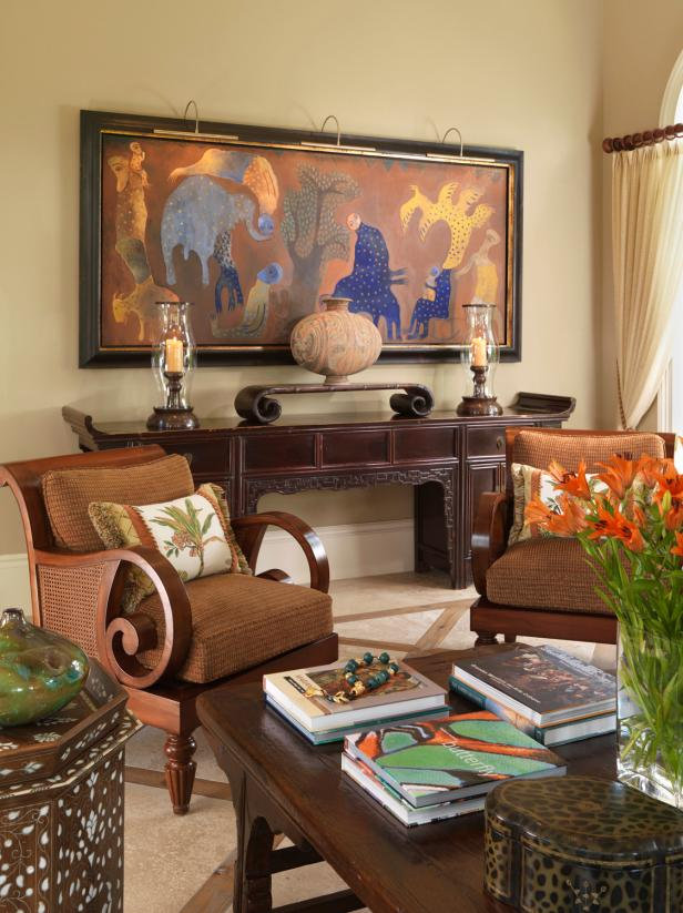 Neutral Living Room With Brown Cane Armchairs and Colorful Painting