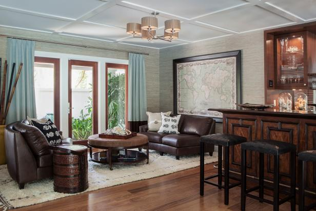 Bar and Sitting Area With Neutral Wallpaper and Brown Leather Sofas
